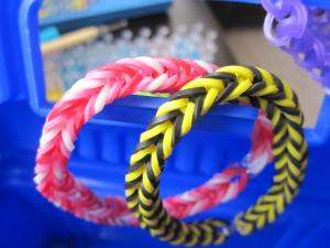 Our first projects - two fishtail bracelets and a single band done in one color.