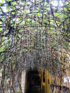 The arch at the back entrance at Padre Pio Chapel. Notice the hundred of rosaries hanging there. A tremendous and overwhelming show of faith.