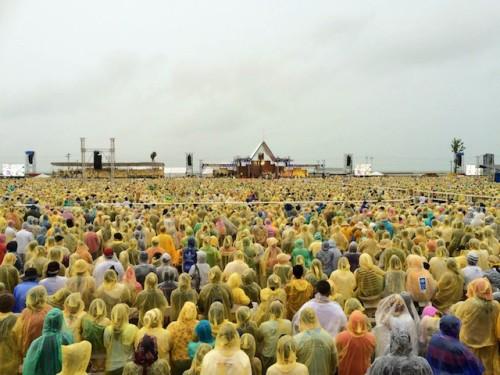 A virtual sea of yellow, everyone wearing raincoats because of the typhoon.